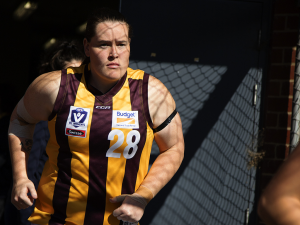 Sarah Perkins runs out for Hawthorn's VFLW side