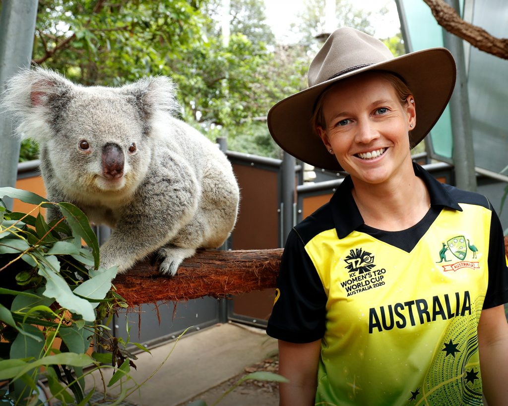 Meg Lanning smiling with koala