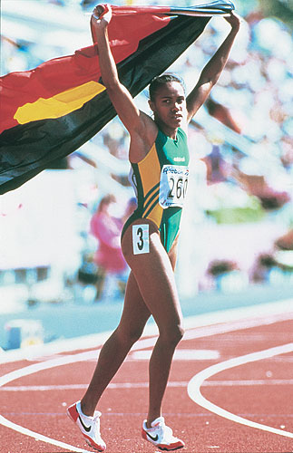 Image is of Cathy Freeman after a race at the 1994 Commonwealth Games. She holds the Aboriginal flag. Siren Sport. Australian Sports Museum.
