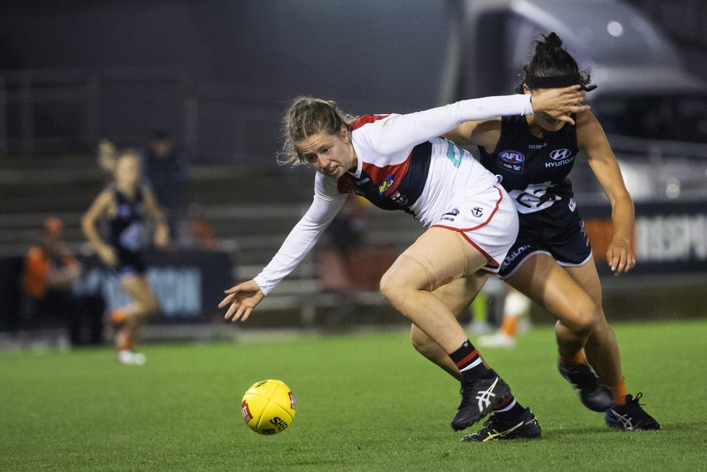 Nat Exon chases a loose ball in AFLW round five. Image: Megan Brewer