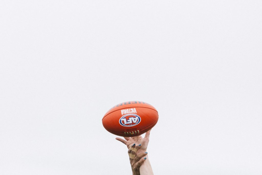Hands up to tap the ball out of the air. Image: She Scores