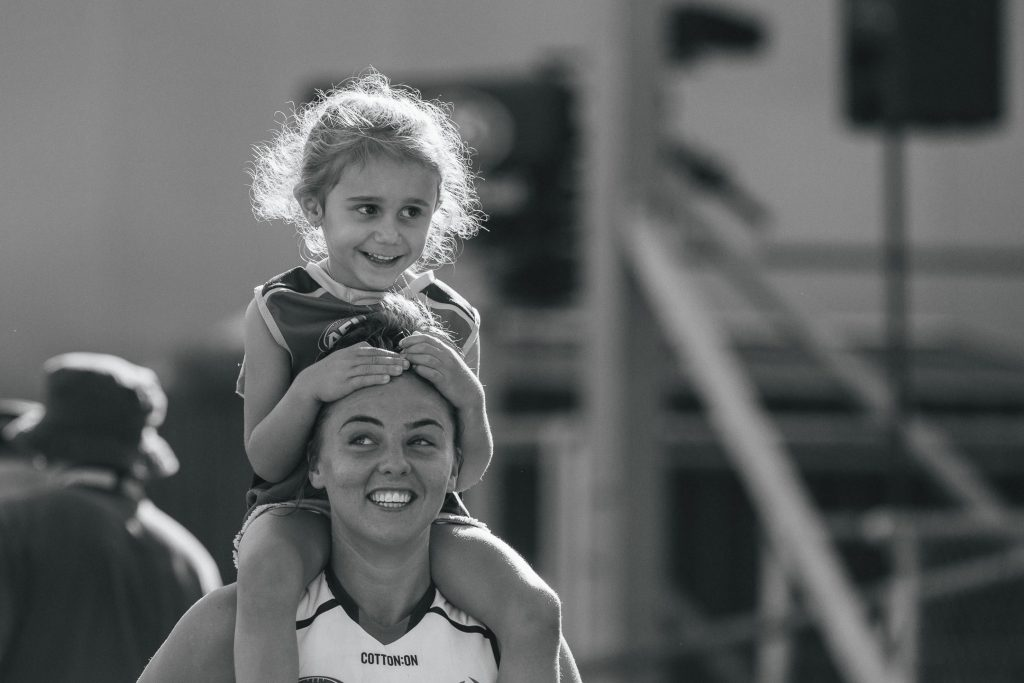 Ebony Marinoff carries Erin Phillips' niece on her shoulders. Image: She Scores