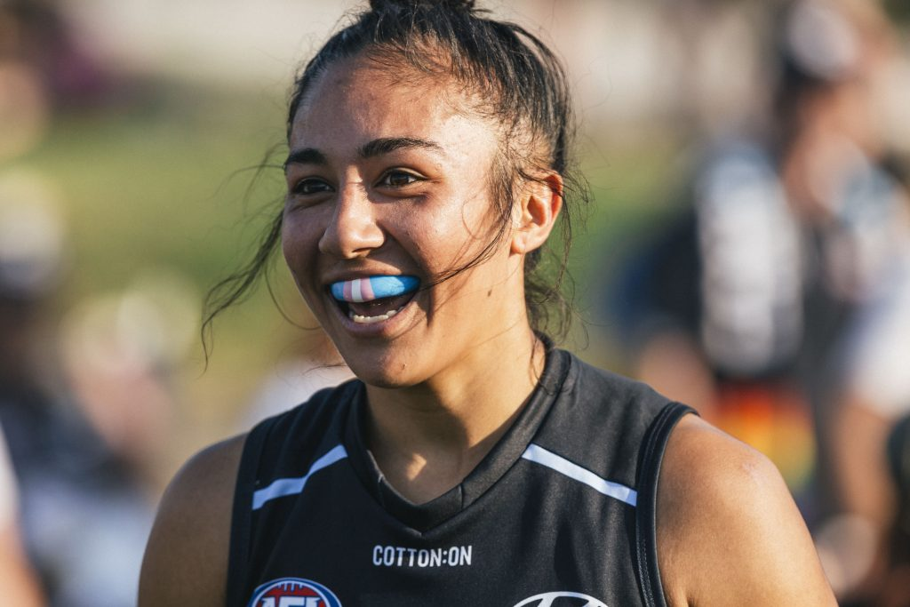 Darcy Vescio proudly wears a trans-pride mouthguard. Image: She Scores