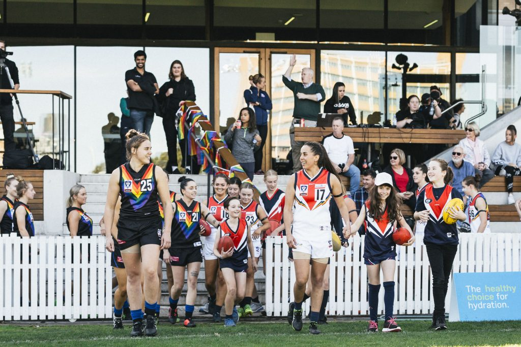 Melbourne University and Darebin Falcons run out in their specially designed pride guernseys. Image: She Scores