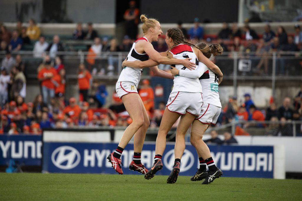 Kate Shierlaw celebrates a goal with Rhiannon Watt and Nat Exon. Image: Megan Brewer