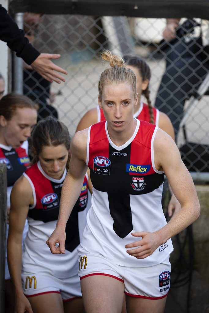 Kate Shierlaw leads the Saints out. Image: Megan Brewer