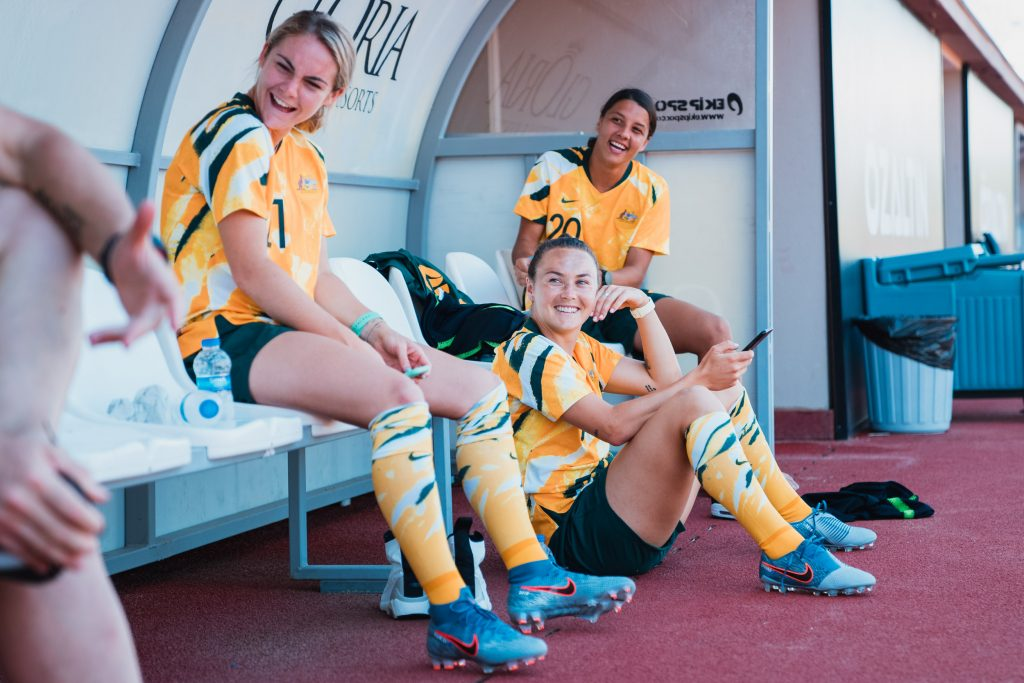 Three Matildas take a moment on the sidelines. Image: By The White Line / Rachel Bach Women in sport photography