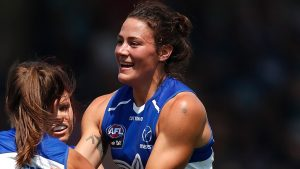 Kate Gillespie-Jones celebrates a goal with teammates. Image: North Melbourne Kangaroos