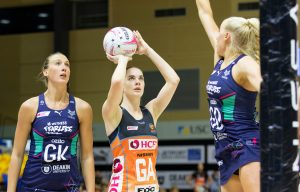 Kiera Austin shoots for goal against the Vixens. Image: Suncorp Super Netball