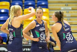 Jo Weston, Emily Mannix & Kate Eddy of Melbourne Vixens confer. © 2020 Eyes Wide Open Images Barry Alsop Photographer