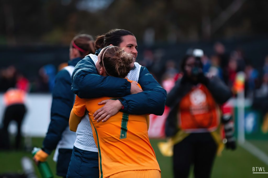 Lydia Williams and Steph Catley share a hug after the final whistle. Image by Rachel Bach (@bythewhiteline) Photographing the Matildas