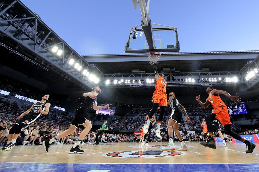 Scott Machado of the Cairns Taipans scores during the boxing day NBL open air game in Melbourne.