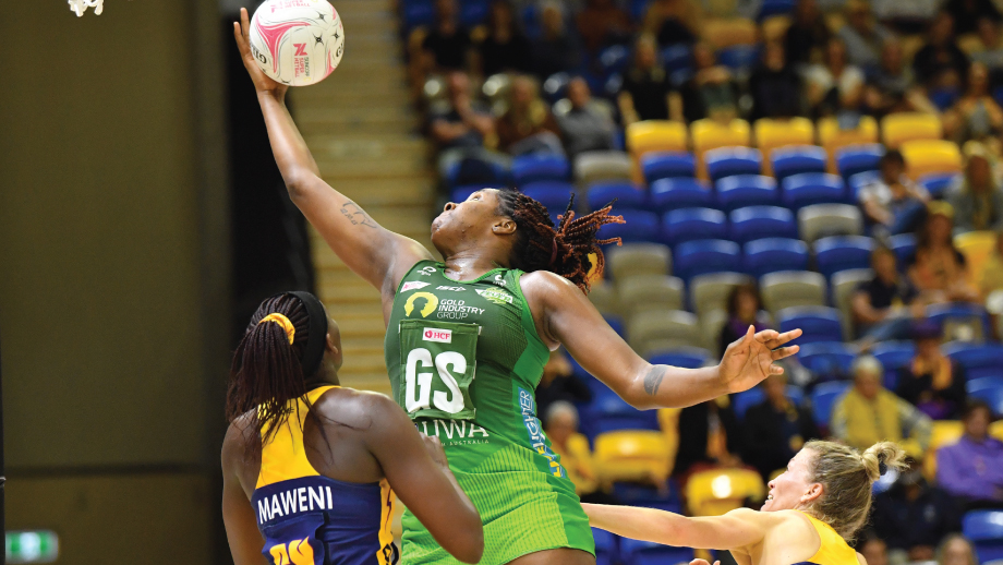 Jhaniele Fowler stretches for the ball against the Lightning. Image: Suncorp Super Netball Round Eleven