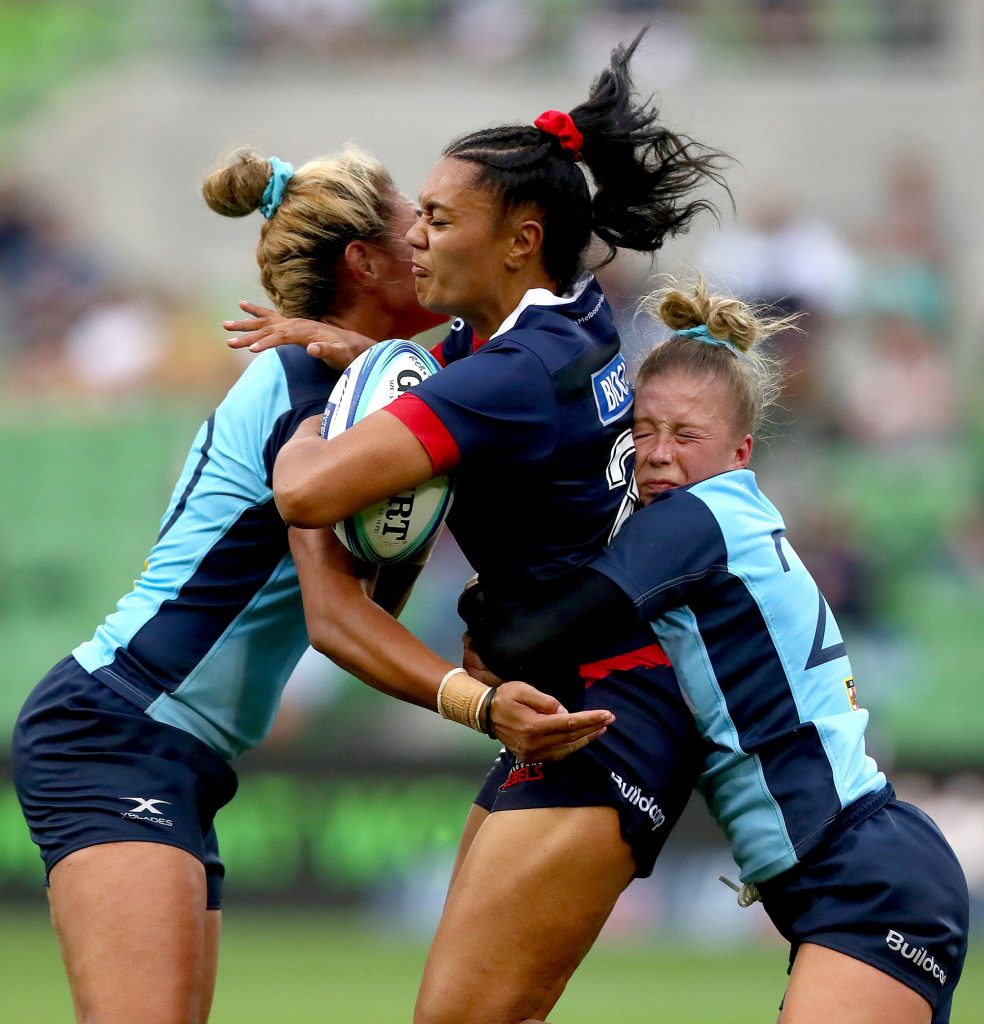 Tyra Boysen of the Rebels is tackled by Layne Morgan of the Waratahs (R) during the 2020 Round 1 SuperW match.