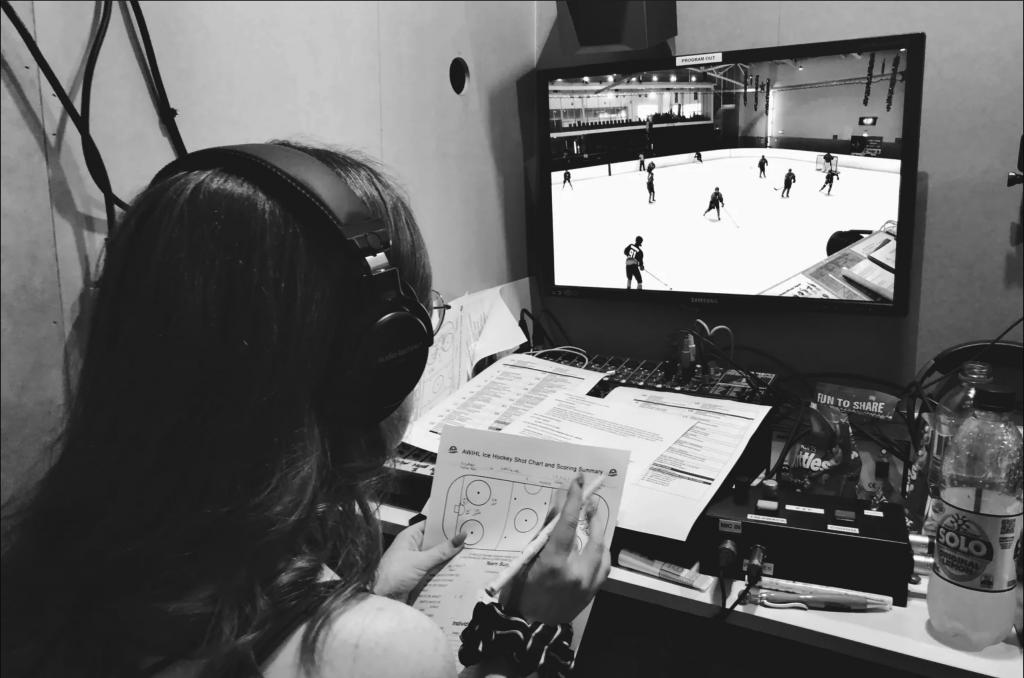 Alyssa Longmuir at work tracking data. Alyssa Longmuir ice hockey