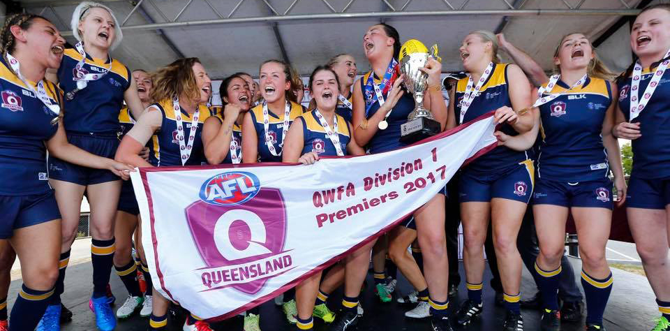 The Sharkettes celebrate their first QWFA Premiership in 2017. Source: AFL Queensland