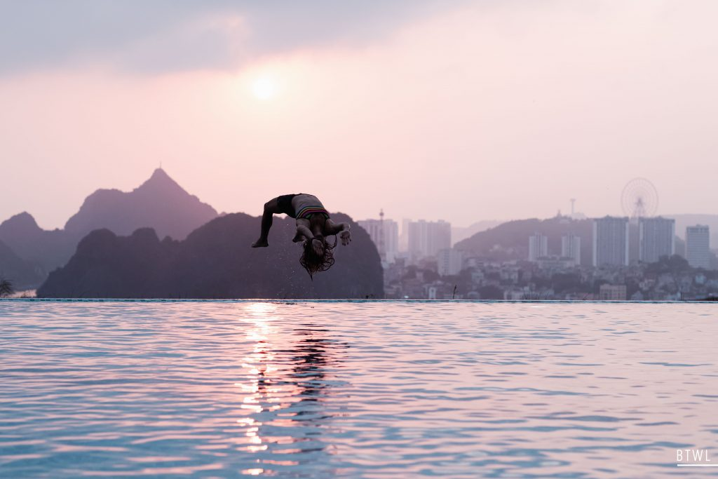 Aivi Luik jumps into the pool during a recovery session in Vietnam. Image: Rachel Bach / By The White Line