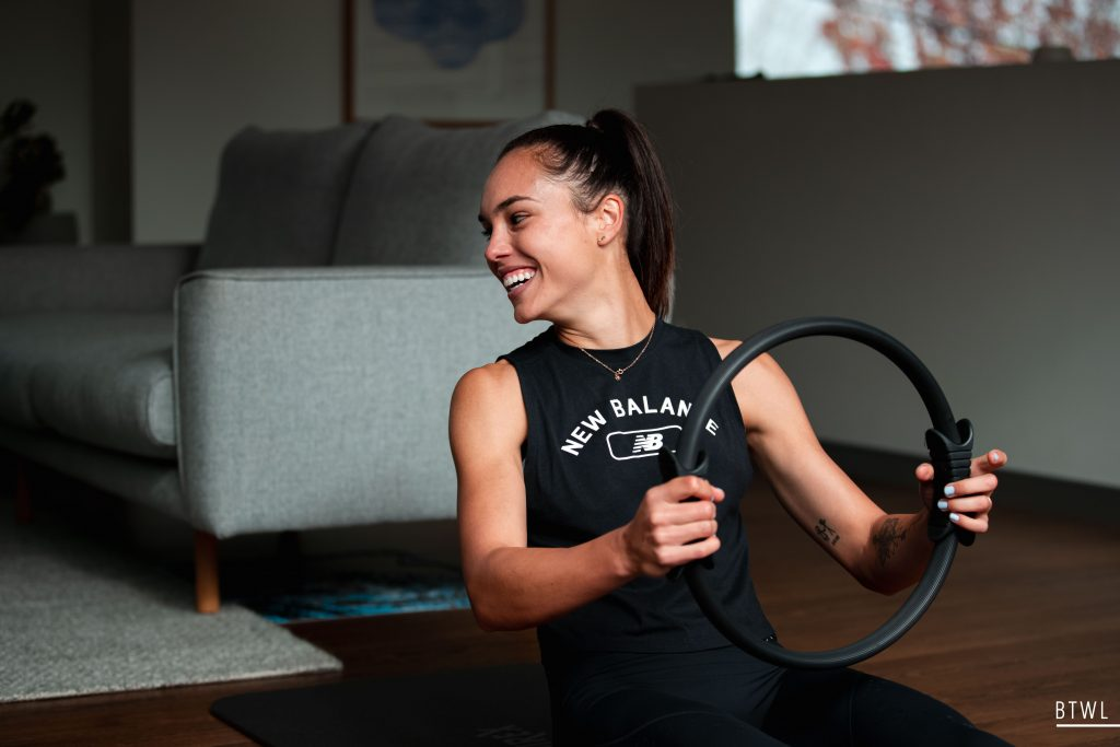Emma Checker completes a home workout during the first Melbourne lockdown. Image: Rachel Bach / By The White Line