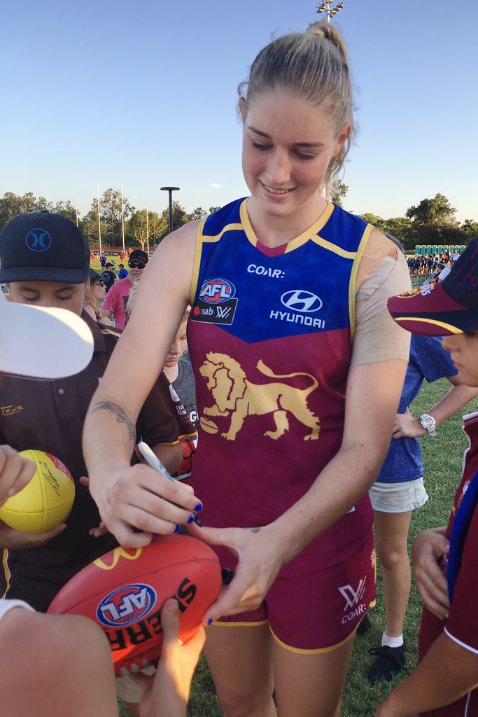 Tayla Harris signing a fan's footy in 2017. Image: Megan Brewer