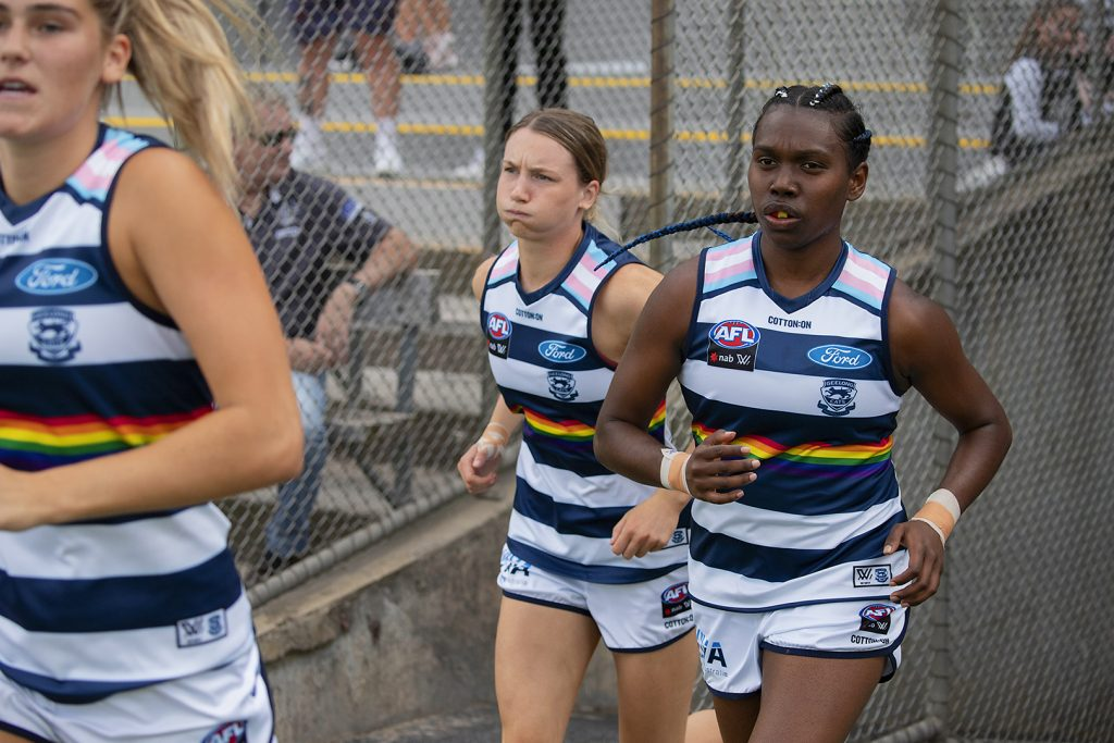 Stephanie Williams runs out for her  debut in Geelong's pride guernsey in AFLW round two. Image: Megan Brewer