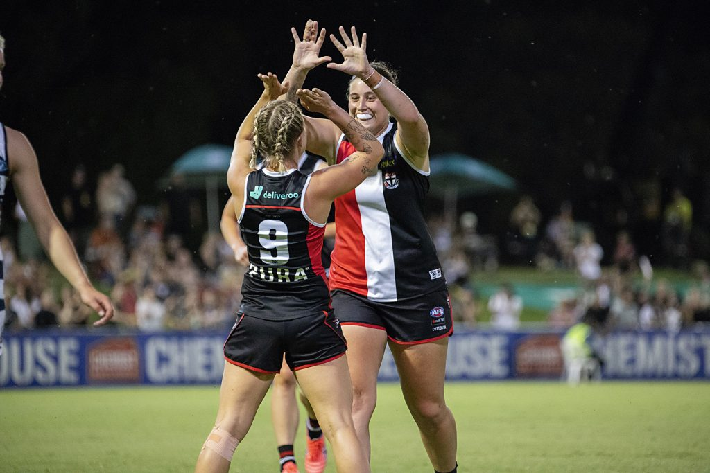 Kate McCarthy and Caitlin Greiser celebrate a goal against the Cats. Image: Megan Brewer