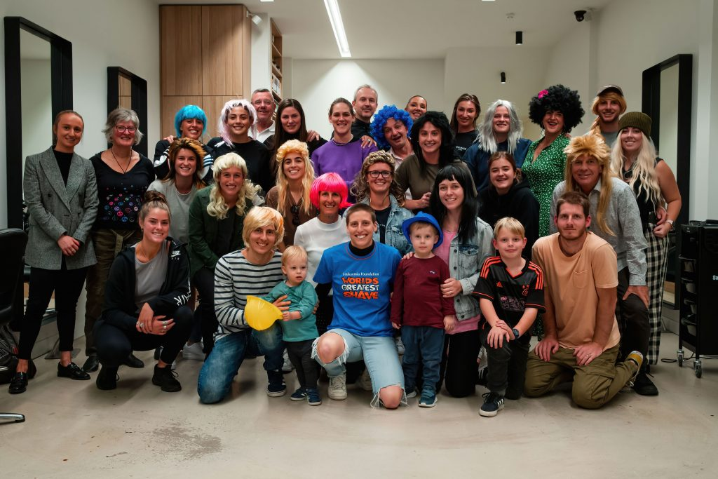 Rebekah Stott with family and friends after participating in the World's Greatest Shave. Image: Rachel Bach / By The White Line