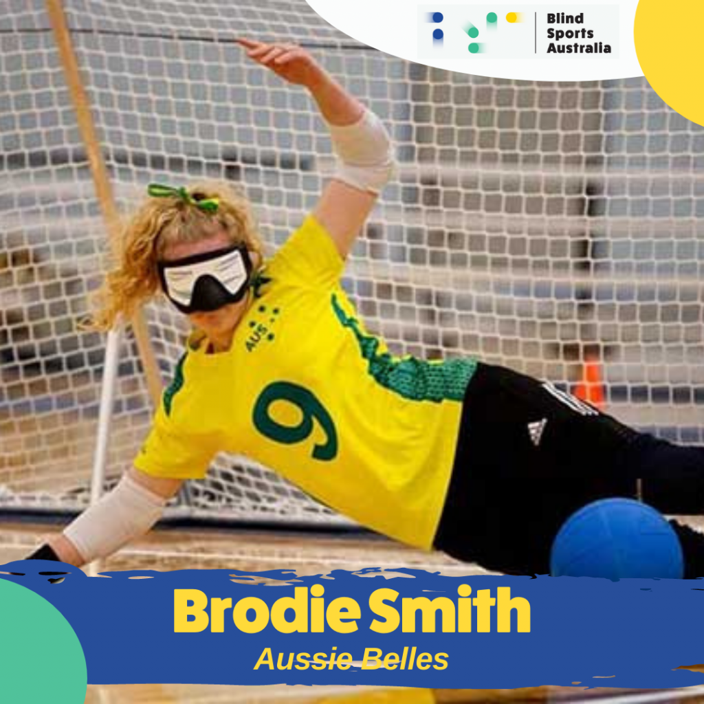 Image is of Aussie Belle Brodie Smith defending. The blue ball is hitting her legs while she sits across the court, legs stretched out and propped up on one arm.