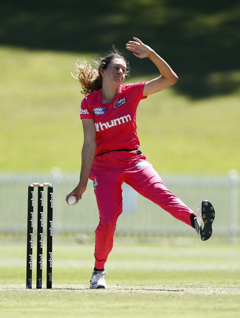 SYDNEY, AUSTRALIA - NOVEMBER 15: Emma Hughes of the Sixers bowls during the Women's Big Bash League WBBL match between the Adelaide Strikers and the Sydney Sixers at Drummoyne Oval, on November 15, 2020, in Sydney, Australia. (Photo by Ryan Pierse/Getty Images)