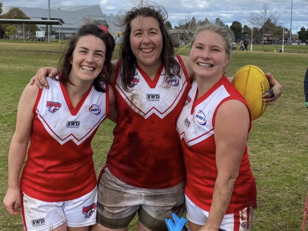 Kel Rowe (middle) has found a home at her community footy club. Image: Supplied