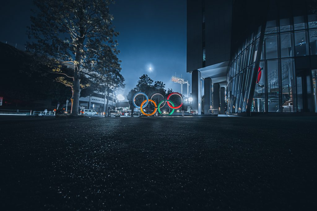 Olympic rings backlit on a dark evening.