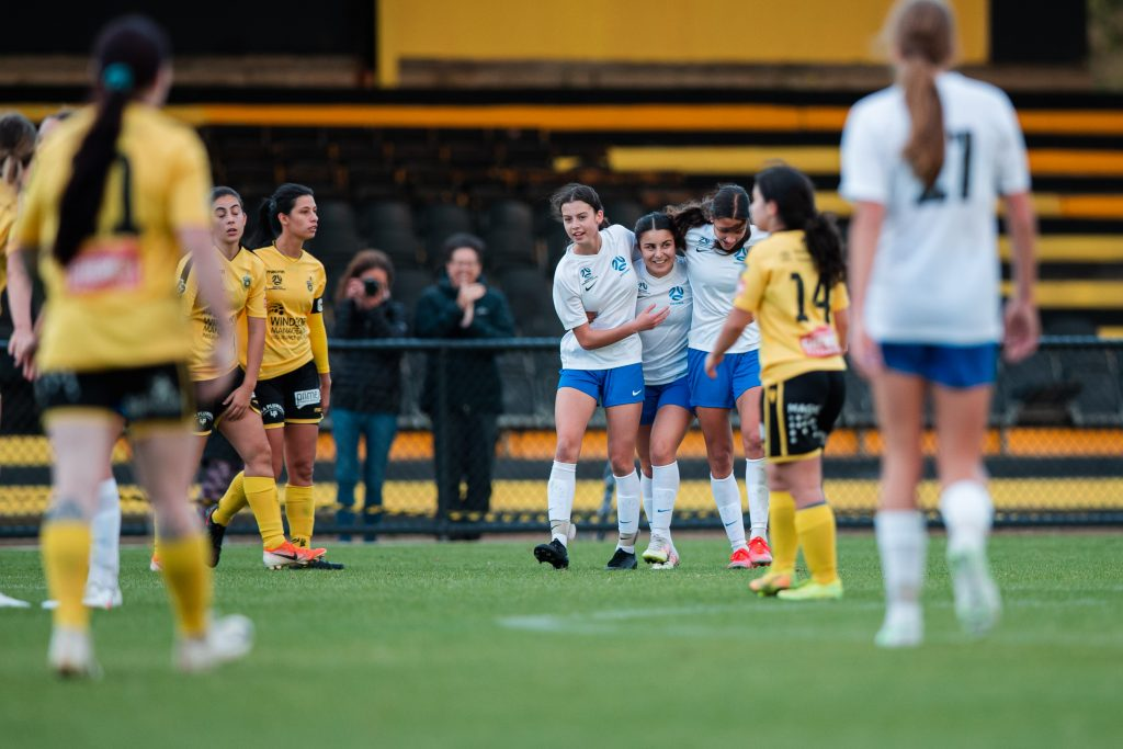 Franny Iermano celebrates a goal with her FV Emerging teammates. Image: Rachel Bach / Football Victoria