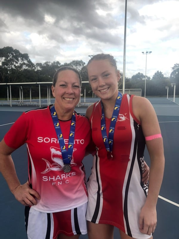 """Shelley O'Donnell and Hannah Mundy after playing in an A-grade grand final together in 2018 for the Sorrento Sharks. """"We didn't win a premiership, but it was a super-cool thing to do,"""" Hannah said. Image: Supplied."""