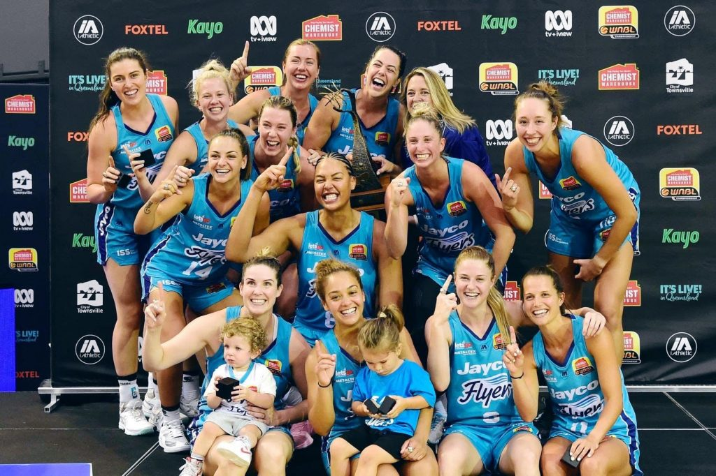 Taylah Giliam celebrates the 20/21 WNBL Championship with her Southside Flyers teammates. Image: supplied